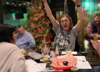 A customer wins Music Bingo at Rotties 221 Biergarten